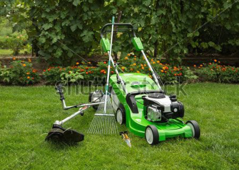 stock-photo-green-lawnmower-weed-trimmer-rake-and-secateurs-in-the-garden-153976919