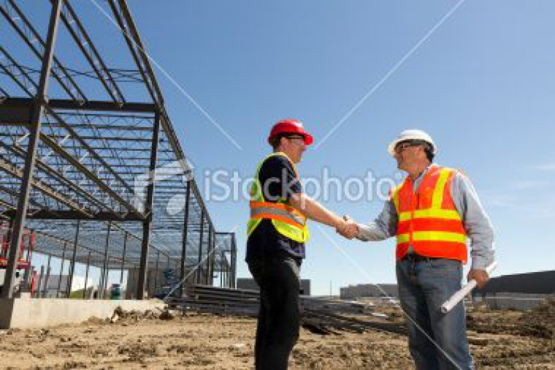 stock-photo-19819821-construction-blueprints-and-handshake